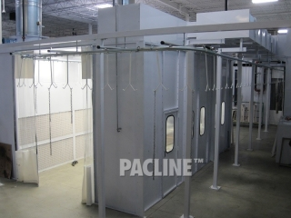 The PAC-LINE overhead enclosed track conveyor goes through a paint booth system.