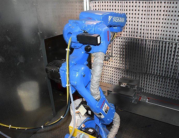 Robot for precise spot painting of automotive parts.