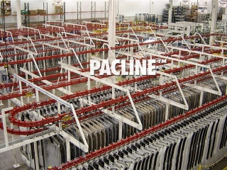 Power and free conveyor used to close pack automotive headliners for WIP live storage.