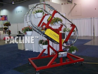Demonstrates the functionality and versatility of the enclosed track system for handling hanging plants.
