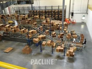 Empty box conveyor for large warehouse utilizing overhead space.