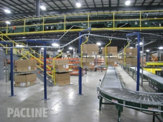 Empty carton and tote conveyor for split-case picking operations.