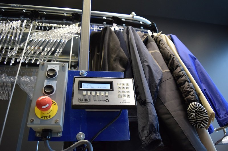 Automated storage and retrieval system for coat check conveyor
