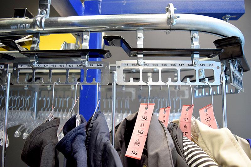 Coat check conveyor with checks
