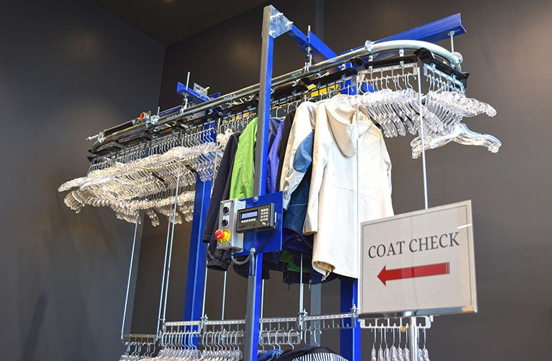 A coat check conveyor for conference center