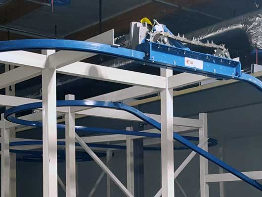 Overhead monorail conveyor with modular track components for easy installation