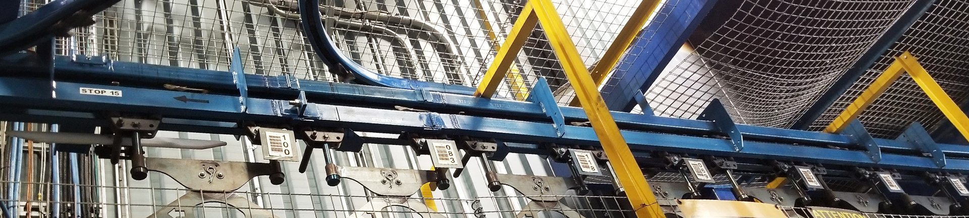Pacline carries Unibilt power and free conveyors