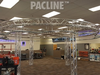 PAC-LINE™ enclosed track conveyor for a drone creative display system.
