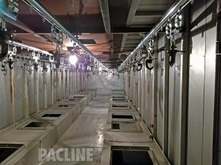 Overhead paint conveyor for a powder coating line.