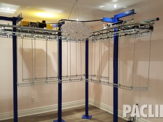 Residential garment conveyor for clothing storage.