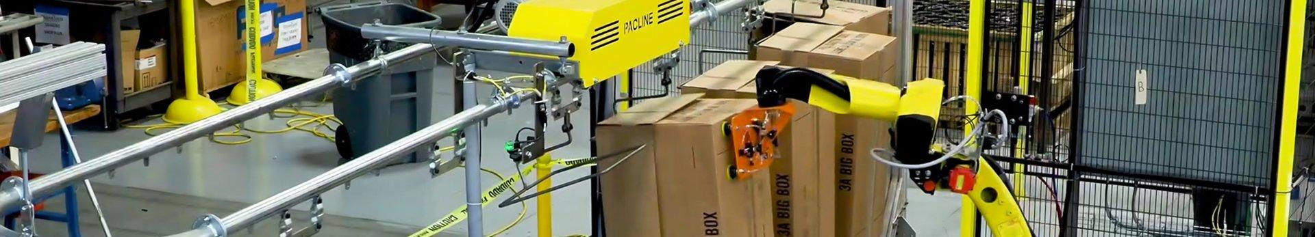 robotic loading on an overhead conveyor