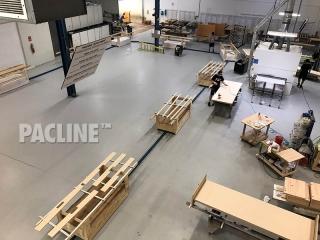Towline conveyor for wood furniture finishing facility