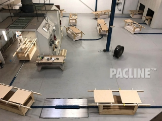 In-floor conveyor system for wood furniture finishing system.