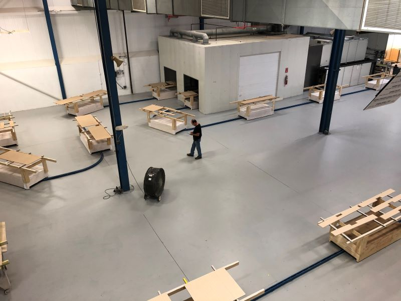 in-floor towline conveyor for wood finishing