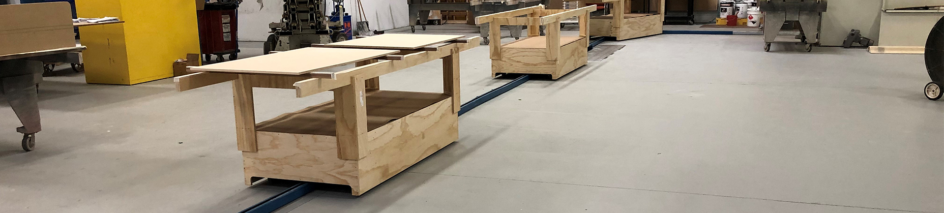 Woodworking paint and finish towline conveyor